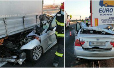 Șofer mort după un impact devastator. A intrat cu BMW-ul sub TIR